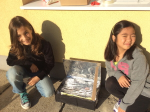 Anelise and Anita with their solar oven